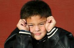 confused barn för pojke Arkivbild