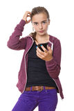 Confused beautiful teenage girl with mobile phone, , isolated on Stock Photos