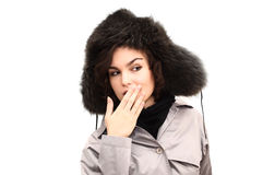 Confused beautiful woman in fur hat Royalty Free Stock Image