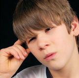 Confused Boy. This boy is in a state of confusion.  What can't he figure out Royalty Free Stock Photography