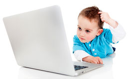 Confused boy with a computer Stock Image