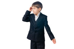 Confused boy scratching his head looking sideways Stock Photos