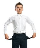 Confused boy showing empty pockets. Isolated Royalty Free Stock Images
