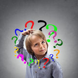 Confused boy thinking with question mark around his head Stock Image