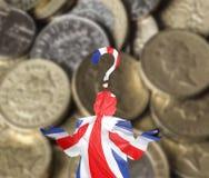 Confused British silhouette over British pound stock photo