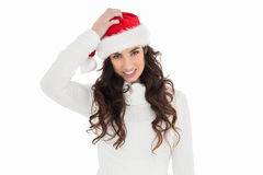 Confused brunette in santa hat Royalty Free Stock Photography