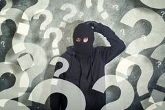 Confused burglar with lot of questions Stock Image
