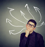 Confused business man with many twisted arrows Royalty Free Stock Photos