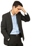 Confused business man smiling Stock Image