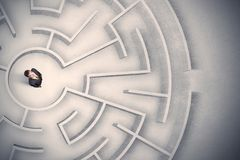 Business man trapped in a circular maze. Confused business man trapped in a circular maze Stock Image