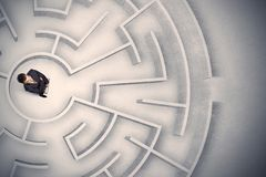 Business man trapped in a circular maze Royalty Free Stock Photos