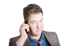 Confused business person on cell phone. Close call. Face of a male business person looking uncertain while on a corporate cell phone. Call of confusion Royalty Free Stock Photo