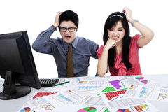 Confused business team analyzing business chart Royalty Free Stock Photo