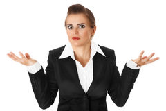 Confused business woman. Confused modern business woman isolated on white stock image