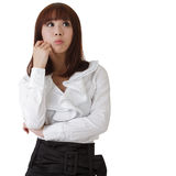 Confused business woman. Oriental office lady against white Stock Images