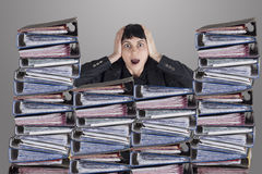 Confused business woman with files Stock Images