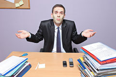 Confused businessman. In an office stock images