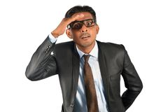 Confused businessman in black suit looking. Over white background Stock Images