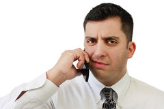 Confused Businessman On Cellphone royalty free stock images