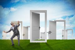 The confused businessman in front of doors. Confused businessman in front of doors Royalty Free Stock Photography