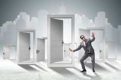 The confused businessman in front of doors. Confused businessman in front of doors Stock Image