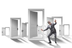 The confused businessman in front of doors. Confused businessman in front of doors Royalty Free Stock Photos