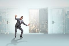 The confused businessman in front of doors. Confused businessman in front of doors Royalty Free Stock Photo