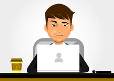 Confused Businessman. In front of Laptop Stock Photo
