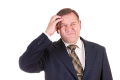 Confused businessman with gesture. On his face, isolated on white Royalty Free Stock Photography