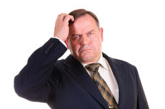 Confused businessman with gesture Royalty Free Stock Photography