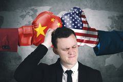 Confused businessman with government conflict. Image of Caucasian businessman looks confused with government conflict of China and USA Royalty Free Stock Photos
