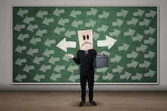 Confused businessman with guidance arrows Stock Photos