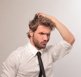 Confusion. Confused businessman with hand in the hair Stock Photos