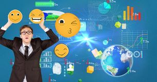 Confused businessman holding emojis with various icons in background. Digital composite of Confused businessman holding emojis with various icons in background stock photography