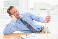 Confused businessman holding the phone Royalty Free Stock Photo