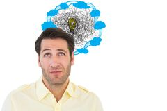 Confused businessman looking light bulb amidst clouds icon Royalty Free Stock Images