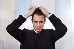 Confused businessman pulling hair Stock Photography