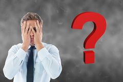 Confused businessman by question mark. Digital composite of Confused businessman by question mark Stock Photos
