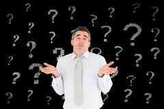 Confused businessman with question mark signs. Digital composite of Confused businessman with question mark signs Stock Images