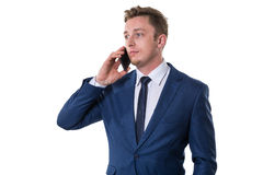 Confused businessman talking on cellphone Stock Photos
