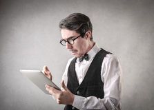 Confused businessman using a tablet Stock Photo