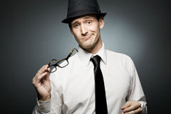 Confused businessman in white shirt and black hat. Stock Photos