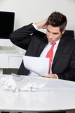 Confused Businessman Working At Desk Stock Photos