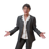 Confused businesswoman. Confused mature businesswoman with hands out isolated on white background Royalty Free Stock Images