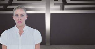 Confused businesswoman against maze. Digital composite of Confused businesswoman against maze Stock Image