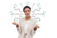 Confused businesswoman with arrows and question marks. Digital composite of Confused businesswoman with arrows and question marks Stock Photography