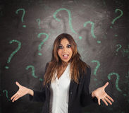 Confused businesswoman. With green question marks background Royalty Free Stock Photos
