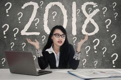 Confused businesswoman with number 2018 stock photo