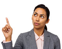 Confused Businesswoman Pointing Upwards Royalty Free Stock Photography