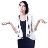 Confused Businesswoman. Portrait of a confused businesswoman on white background Stock Photos